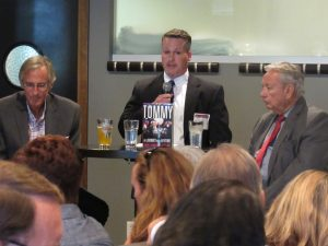 Director Ryan Owens introduces Tommy Thompson at a book event