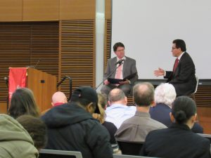 Dean Strang and Alberto Gonzales and attentive audience