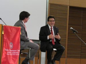Dean Strang and Alberto Gonzales gesturing to self
