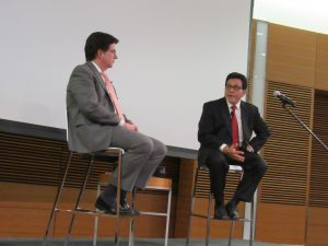 Dean Strang and Alberto Gonzales seated